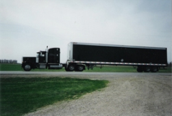 With Brenny Specialized, we kind of put the cart before the horse. We purchased a trailer before we had a truck to pull it! We paid someone to pull it home from an auction in IL. Soon to follow was the black Pete, which Todd still drives to this day!